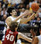 Sabatino Chen of Colorado goes to the basket on John Gage of Stanford during the second half of the January 24th, 2013 game in Boulder.