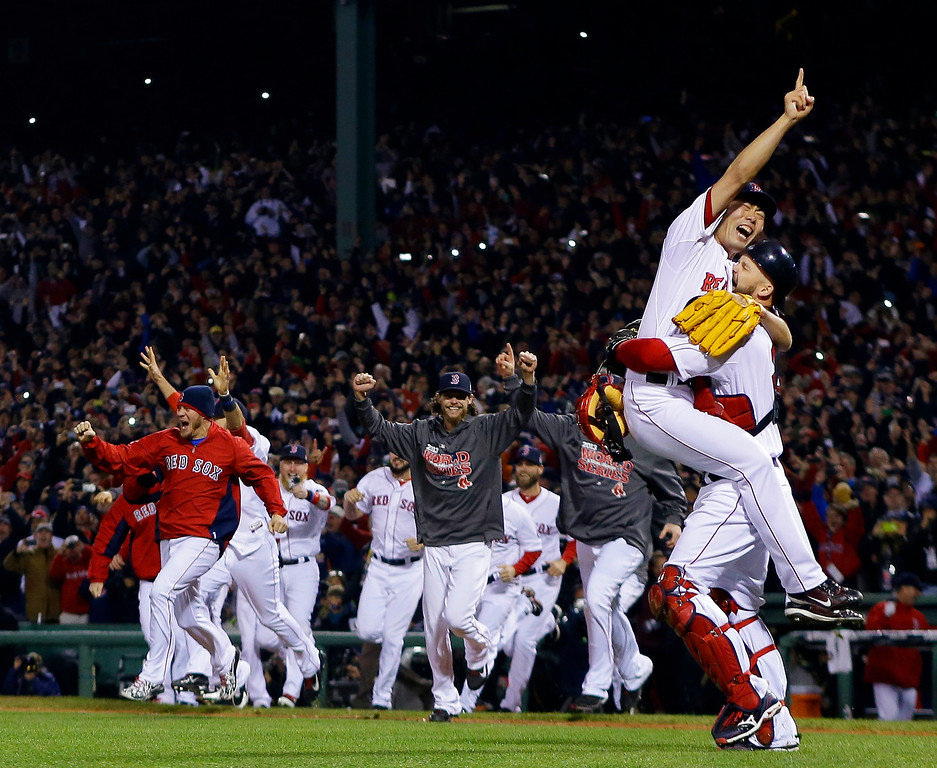 Description of . Boston Red Sox relief pitcher Koji Uehara and catcher David Ross celebrate after getting St. Louis Cardinals' Matt Carpenter to strike out and end Game 6 of baseball's World Series Wednesday, Oct. 30, 2013, in Boston. The Red Sox won 6-1 to win the series. (AP Photo/Matt Slocum)