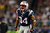 Shane Vereen #34 of the New England Patriots reacts after a ruin in the first quarter against the Houston Texans during the 2013 AFC Divisional Playoffs game at Gillette Stadium on January 13, 2013 in Foxboro, Massachusetts.  (Photo by Elsa/Getty Images)