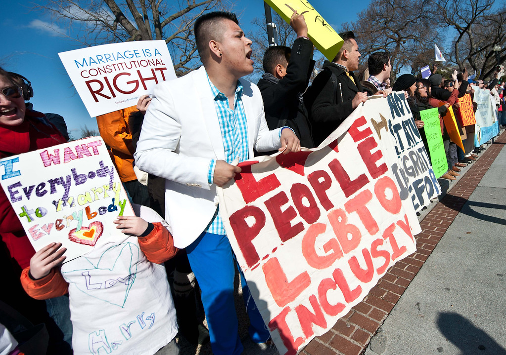 Description of . Supporters of same-sex marriage chant slogans as the anti-gay marriage March for Marriage arrives at the US Supreme Court in Washington,DC on March 26, 2013.   AFP PHOTO/Nicholas KAMM/AFP/Getty Images