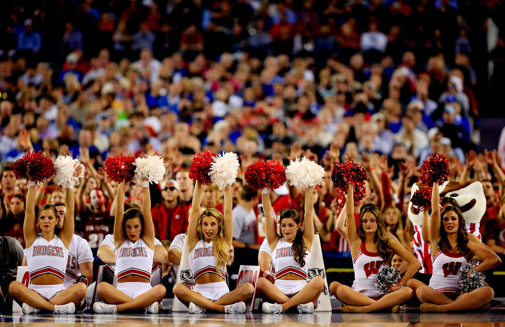 Description of . ARLINGTON, TX - APRIL 05: Wisconsin Badgers cheerleaders perform during the NCAA Men's Final Four Semifinal against the Kentucky Wildcats at AT&T Stadium on April 5, 2014 in Arlington, Texas.  (Photo by Jamie Squire/Getty Images)