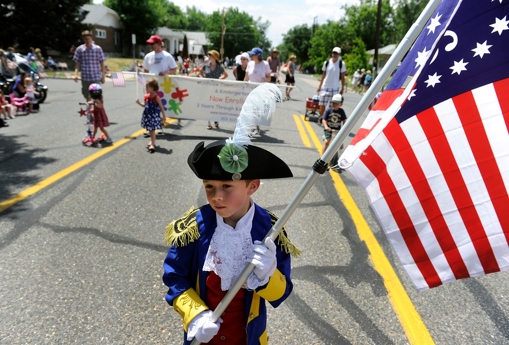 Description of . DENVER, CO - JULY 4: History buff Dalton Bury, 5, dressed as Comte de Rochambeau, a French General who assisted George Washington, leads a group of friends from the Montview Community Preschool and Kindergarten as the fourth annual Park Hill 4th of July Parade winds its way down 23rd Avenue, complete with marching bands, neighborhood sponsored floats, bikes and classic cars. (Photo By Kathryn Scott Osler/The Denver Post)