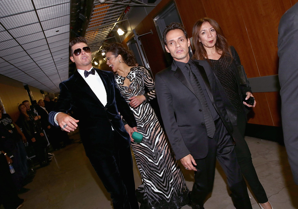 Description of . Singer Robin Thicke (L), actress Paula Patton, singer Marc Anthony and guest attend the 56th GRAMMY Awards at Staples Center on January 26, 2014 in Los Angeles, California.  (Photo by Christopher Polk/Getty Images)