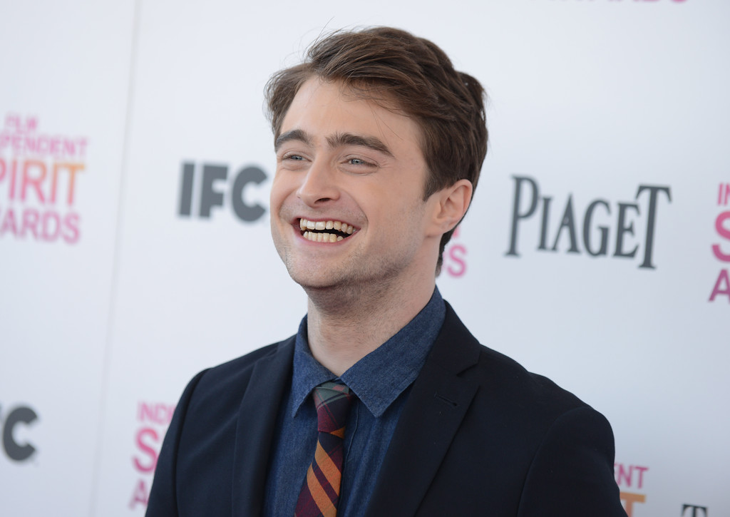 Description of . Actor Daniel Radcliffe arrives at the Independent Spirit Awards on Saturday, Feb. 23, 2013, in Santa Monica, Calif.  (Photo by Jordan Strauss/Invision/AP)