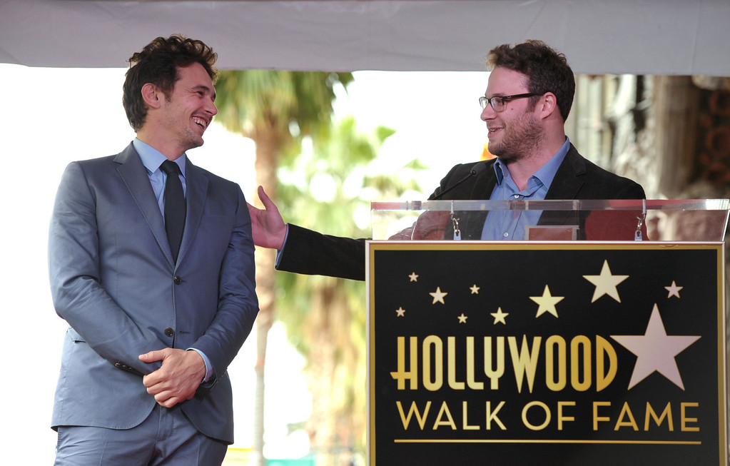 "Description of . Actor James Franco, left, reacts to Seth Rogen\'s remarks at a ceremony honoring Franco with a star on the Hollywood Walk of Fame on Thursday, March 7, 2013 in Los Angeles. Franco and Rogen starred together in the comedy ""Pineapple Express.\"" (Photo by John Shearer/Invision/AP)"