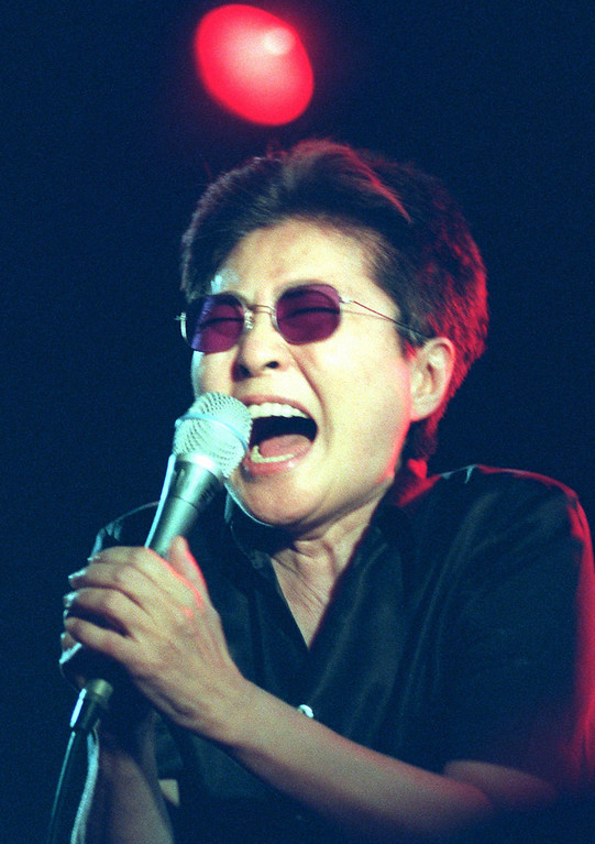 Description of . Yoko Ono, widow of John Lennon, during her performance in the music hall