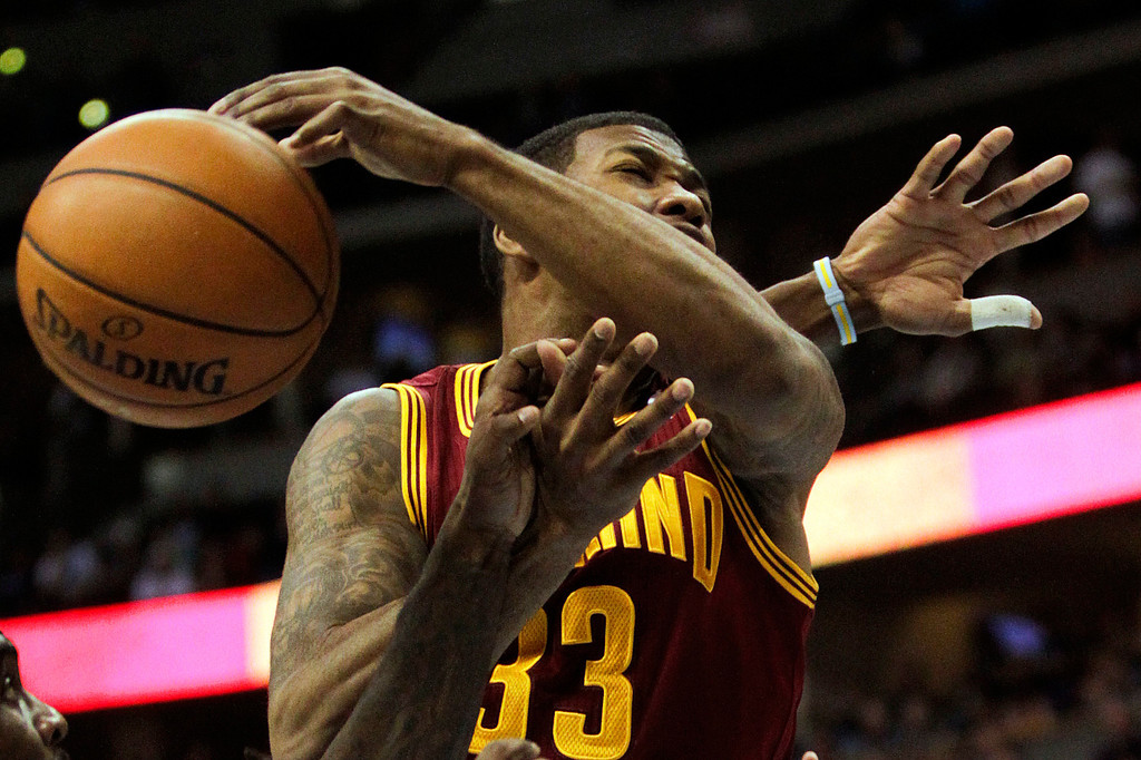 Description of . Cleveland Cavaliers' Alonzo Gee (33) goes up for a rebound during the fourth quarter of an NBA basketball game against the Denver Nuggets Friday, Jan. 11, 2013, in Denver. The Nuggets won 98-91 (AP Photo/Barry Gutierrez)