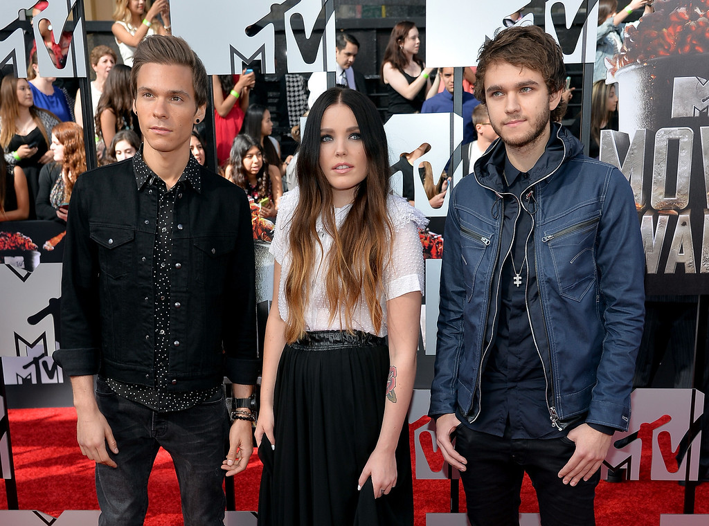 Description of . (L-R) Musicians Matthew Koma, Miriam Bryant and Zedd attend the 2014 MTV Movie Awards at Nokia Theatre L.A. Live on April 13, 2014 in Los Angeles, California.  (Photo by Michael Buckner/Getty Images)