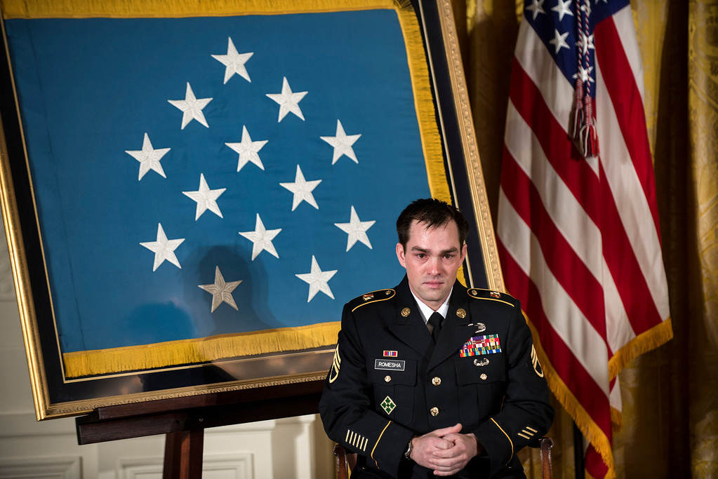 Description of . Retired Army Staff Sargent Clinton Romesha listens during a Medal of Honor ceremony in the East Room of the White House on February 11, 2013 in Washington.    AFP PHOTO/Brendan  SMIALOWSKI/AFP/Getty Images