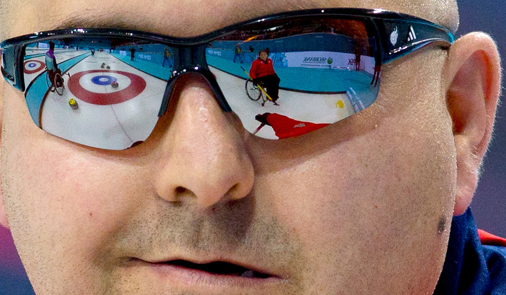 Description of . Gregor Ewan of Great Britain smiles during round robin session wheelchair curling match against South Korea at the 2014 Winter Paralympics in Sochi, Russia, Sunday, March 9, 2014. Great Britain won 8-4. (AP Photo/Pavel Golovkin)
