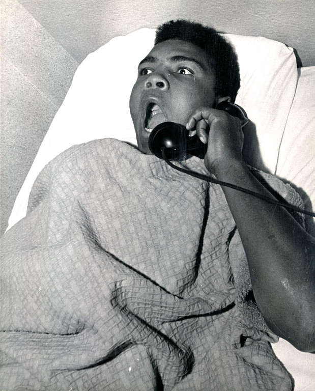 Description of . After a night of making Denver, and Sonny Liston in particular, aware of his presence.  Cassius Clay and troupe found accommodations at the Albany Hotel.  The Denver Post caught him in bed Tuesday morning asking for the time of day and telling hotel employees what a great night he had Monday on the Liston home's front lawn. 1963 Denver Post Library photo archive