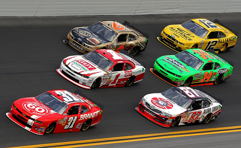Description of . DAYTONA BEACH, FL - FEBRUARY 23: Justin Allgaier, driver of the #31 Brandt Chevrolet, Kurt Busch, driver of the #1 Guy Roofing Chevrolet, Trevor Bayne, driver of the #6 Cargill Ford, Joe Nemechek, driver of the #87 HostGator.com Chevrolet, Danica Patrick, driver of the #34 GoDaddy.com Chevrolet, Sam Hornish Jr., driver of the #12 Alliance Truck Parks Ford, race during the NASCAR Nationwide Series DRIVE4COPD 300 at Daytona International Speedway on February 23, 2013 in Daytona Beach, Florida.  (Photo by Todd Warshaw/Getty Images)