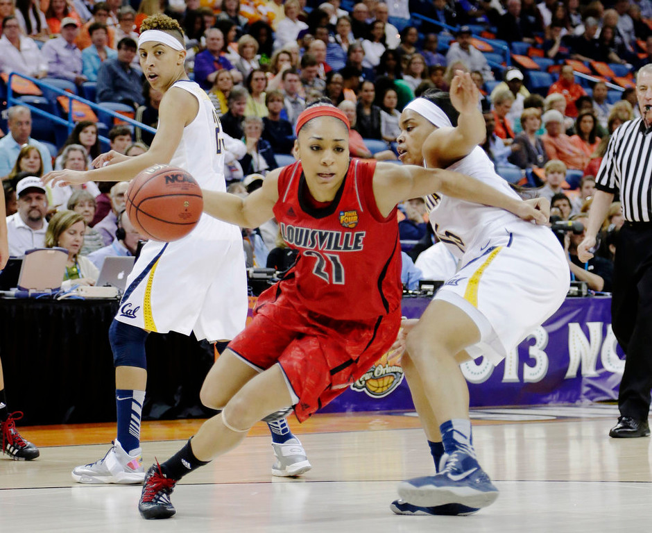 Description of . Louisville guard Bria Smith (21) drives the ball against California guard Brittany Boyd (15) in the first half of a national semifinal at the Women's Final Four of the NCAA college basketball tournament, Sunday, April 7, 2013, in New Orleans. (AP Photo/Gerald Herbert)