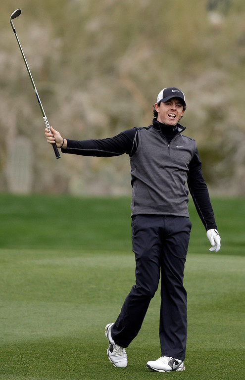 Description of . Northern Ireland\'s Rory McIlroy reacts after a shot on the 10th fairway in the first round against Shane Lowry, of Ireland, during the Match Play Championship golf tournament, Thursday, Feb. 21, 2013, in Marana, Ariz. (AP Photo/Ted S. Warren)