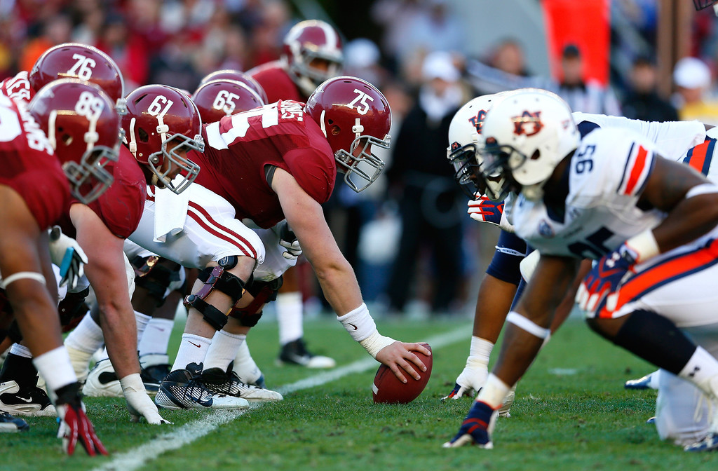 Description of . The Alabama Crimson Tide offense faces off against the Auburn Tigers defense at Bryant-Denny Stadium on November 24, 2012 in Tuscaloosa, Alabama.  (Photo by Kevin C. Cox/Getty Images)