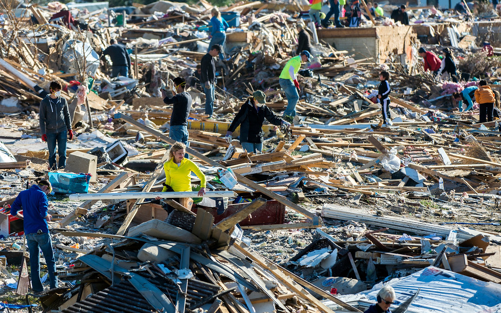 Description of . Homeowners and helpers dig out what they can from a mountain of debris in Washington, Ill., Tuesday, Nov. 19, 2013 after more than 1,000 homes were devastated  by an F4 tornado that passed through Sunday. The twister was the most powerful to hit Illinois since 1885 with wind speeds greater than 200 mph. (AP Photo/Journal Star, Fred Zwicky)