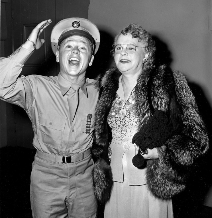 Description of . Pvt. Mickey Rooney attends a Hollywood movie premiere with his mother, Nell Pankey, on Aug. 17, 1944.  The actor is back in Hollywood after completing three months of basic training at Fort Riley, Kansas.  (AP Photo)
