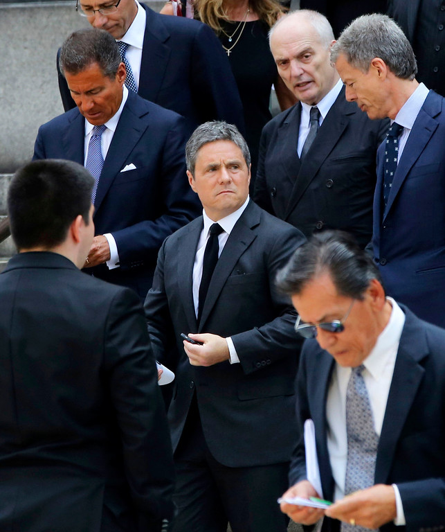 Description of . HBO CEO Richard Plepler, left, Paramount CEO Brad Grey, center, and Soprano's creator David Chase, top second from right, leave the Cathedral Church of Saint John the Divine after the funeral service for James Gandolfini, Thursday, June 27, 2013 in New York.  (AP Photo/Mary Altaffer)