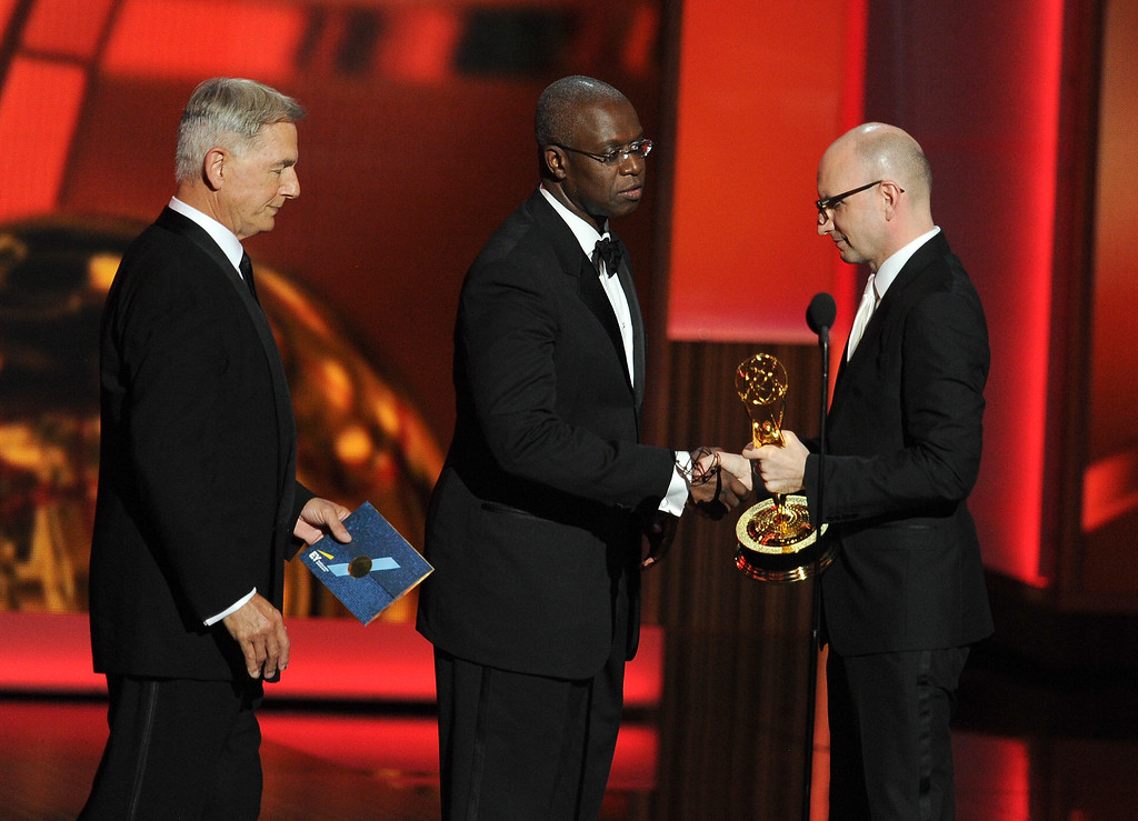 Description of . Actors Mark Harmon (L) and Andre Braugher present an award to Steven Soderbergh onstage during the 65th Annual Primetime Emmy Awards held at Nokia Theatre L.A. Live on September 22, 2013 in Los Angeles, California.  (Photo by Kevin Winter/Getty Images)