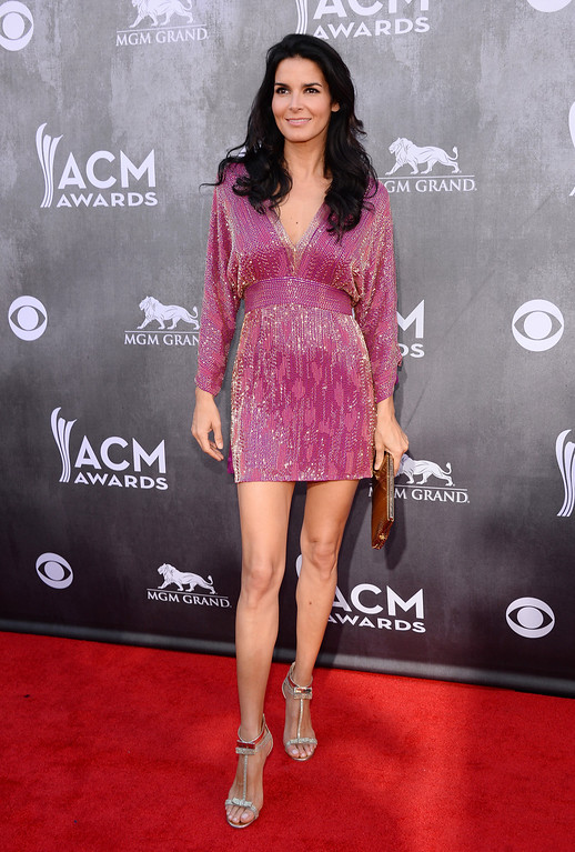 Description of . Angie Harmon arrives at the 49th annual Academy of Country Music Awards at the MGM Grand Garden Arena on Sunday, April 6, 2014, in Las Vegas. (Photo by Al Powers/Powers Imagery/Invision/AP)