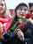 Fan Abbie Bender from Denver, Colorado holds a rose handed out to fans on Valentine's Day during ceremonies honoring Australian actor Simon Baker with a star on the Hollywood Walk of Fame in Hollywood February 14, 2013.  REUTERS/Fred Prouser