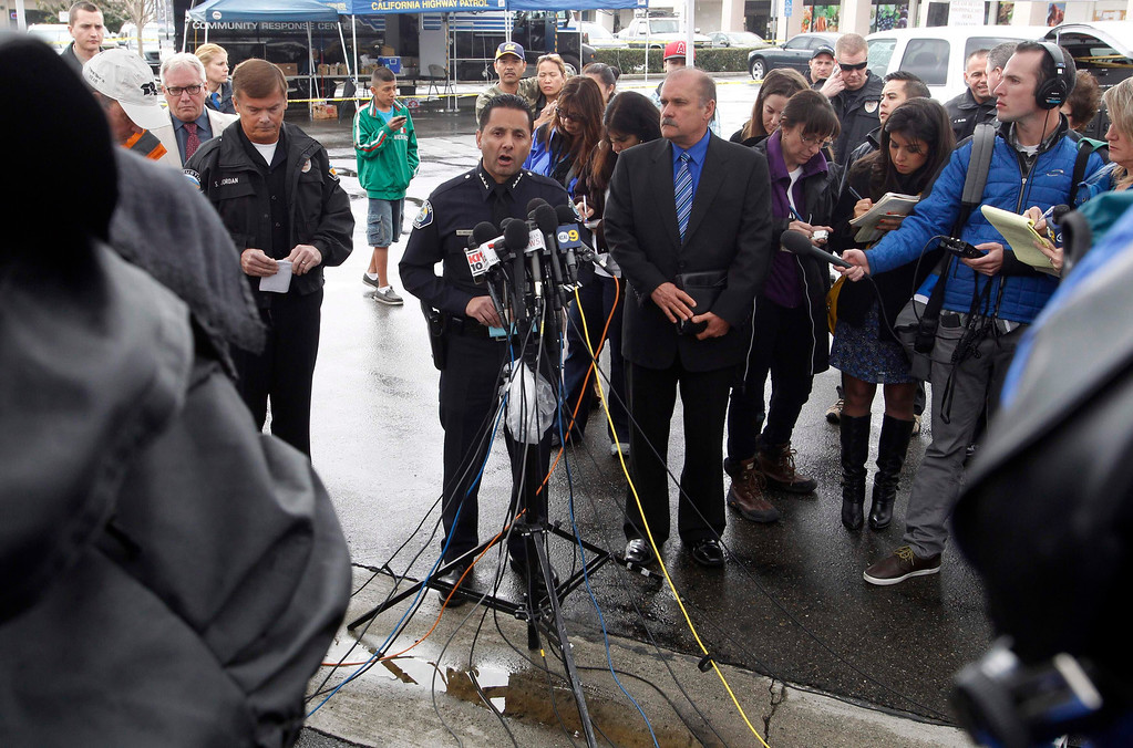 Description of . Orange County sheriff\'s spokesman Jim Amormino (R) with Santa Ana Police Chief Carlos Rojas (C) talk about the Tuesday shooting events during a news conference in Tustin, California February 19, 2013.REUTERS/Alex Gallardo