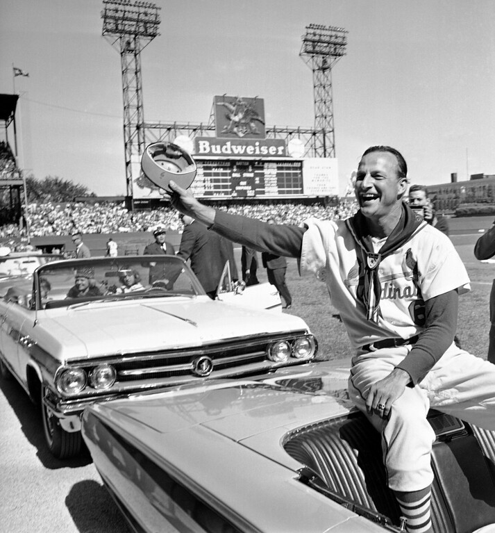 Description of . FILE - In this Sept. 29, 1963 file photo, St. Louis Cardinals' Stan Musial waves to fans during ceremonies marking the his last game as a player before a baseball game against the Cincinnati Reds in St. Louis. Musial, one of baseball's greatest hitters and a Hall of Famer with the Cardinals for more than two decades, died Saturday, Jan. 19, 2013, the team announced. He was 92. (AP Photo/File)