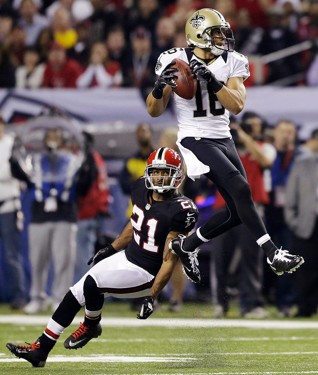 Description of . New Orleans Saints wide receiver Lance Moore (16) makes a catch in front of Atlanta Falcons defensive back Chris Owens (21) during the first half of an NFL football game, Thursday, Nov. 29, 2012, in Atlanta. (AP Photo/David Goldman)