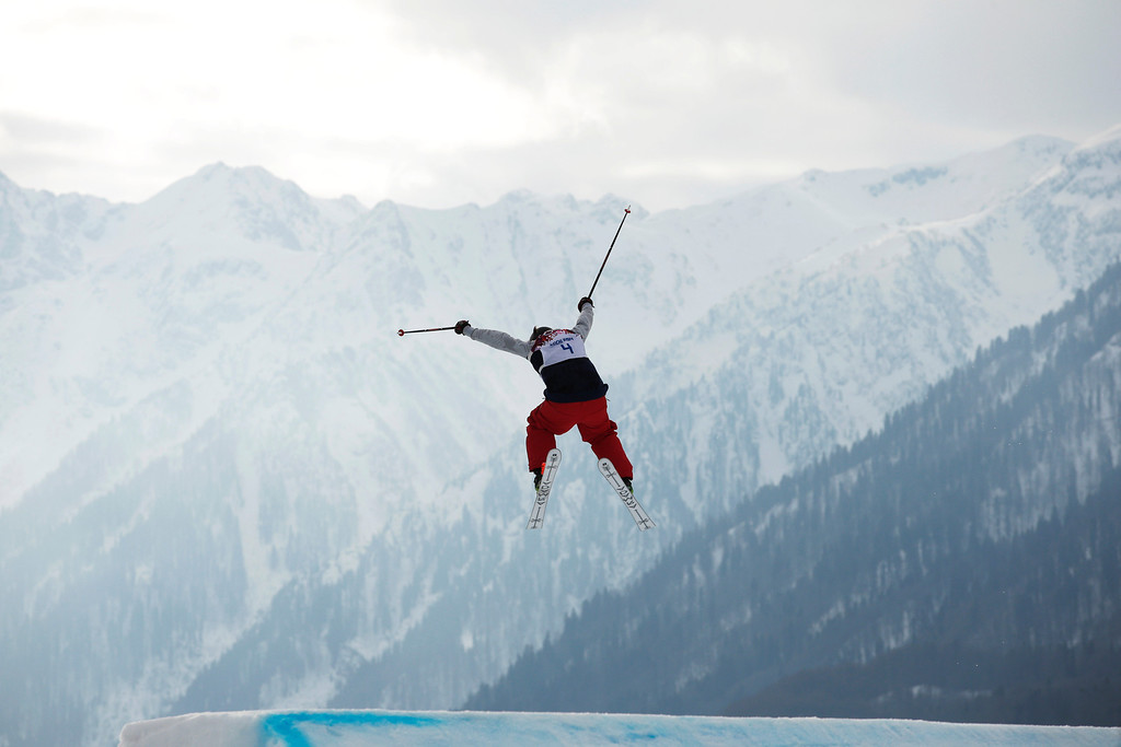 Description of . Devin Logan of the United States takes a jump during the women\'s freestyle skiing slopestyle qualifying at the Rosa Khutor Extreme Park, at the 2014 Winter Olympics, Tuesday, Feb. 11, 2014, in Krasnaya Polyana, Russia. (AP Photo/Jae C. Hong)