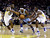 Denver Nuggets' Ty Lawson, center, tries to dribble through Golden State Warriors' Charles Jenkins (22) and Draymond Green during the first half of an NBA basketball game in Oakland, Calif., Thursday, Nov. 29, 2012. (AP Photo/Marcio Jose Sanchez)