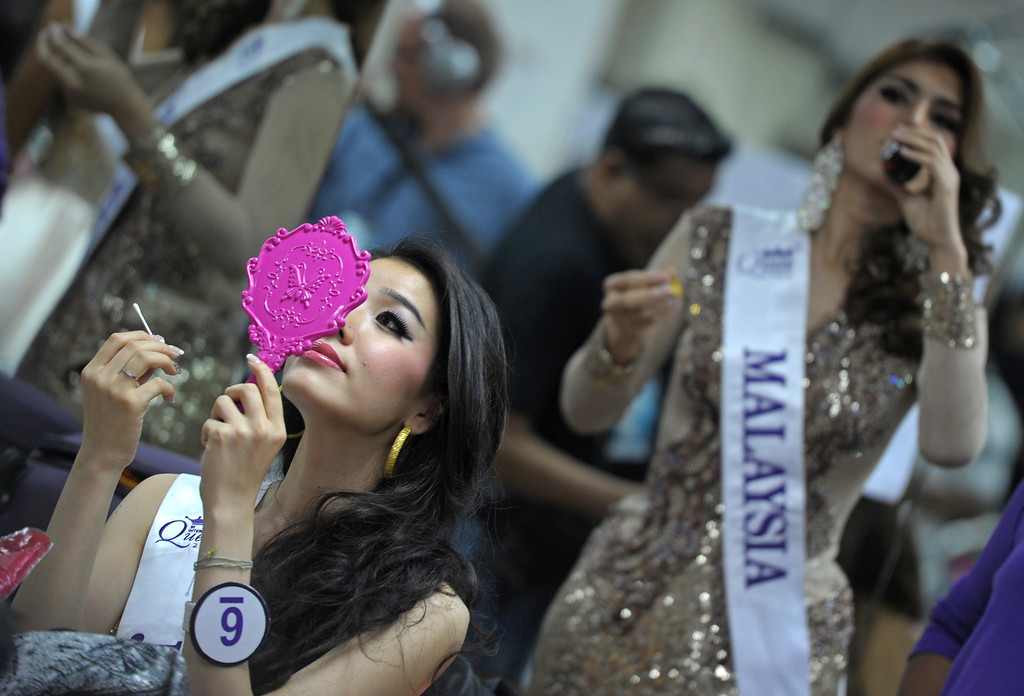 Description of . Contestants make up at backstage during the Miss International Queen 2013 beauty contest in Pattaya resort on November 1, 2013. Twenty-five contestants from 17 countries are to compete in Pattaya for the crown of Miss International Queen since 2004. AFP PHOTO / PORNCHAI  KITTIWONGSAKUL/AFP/Getty Images