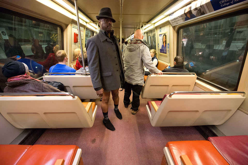 ". A man taking part in the ""No Pants Subway Ride\"" rides a metro train in Washington on January 12, 2014. \""No Pants Subway Ride\"" is an annual event in which transit passengers ride trains without wearing pants in January. The event is observed in dozens of cities worldwide.  NICHOLAS KAMM/AFP/Getty Images"