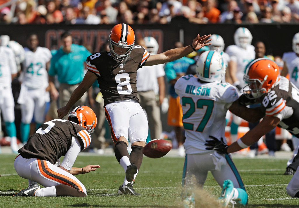 Description of . Cleveland Browns' Billy Cundiff (8) kicks a 39-yard field goal out of the hold of Spencer Lanning in the third quarter of an NFL football game against the Miami Dolphins on Sunday, Sept. 8, 2013, in Cleveland. (AP Photo/Tony Dejak)