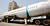 People walk past the fuselage of a Boeing 737 parked on a road in Mumbai May 3, 2007. The trailer carrying the fuselage got stuck on a narrow road in Mumbai while being taken to New Delhi. REUTERS/Arko Datta