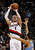 Portland Trail Blazers small forward Luke Babbitt (8) shoots over Denver Nuggets shooting guard Evan Fournier (94) during first quarter of their NBA basketball game in Portland, Oregon, December 20, 2012. REUTERS/Steve Dipaola