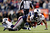Bernard Pierce #30 of the Baltimore Ravens gets tackled by Jerod Mayo #51 of the New England Patriots during the 2013 AFC Championship game at Gillette Stadium on January 20, 2013 in Foxboro, Massachusetts.  (Photo by Jim Rogash/Getty Images)