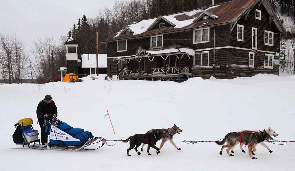 Description of . John Baker arrives at the Anvik, Alaska, checkpoint during the Iditarod Trail Sled Dog Race on Friday, March 8, 2013. (AP Photo/Anchorage Daily News, Bill Roth)