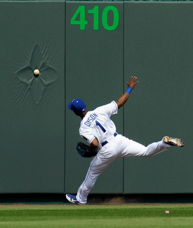 Description of . Kansas City Royals center fielder Jarrod Dyson can't reach a Cleveland Indians Jason Kipnis triple in the first inning during the Royals' home opener in their MLB American League baseball game in Kansas City, Missouri, April 13, 2012.  REUTERS/Dave Kaup