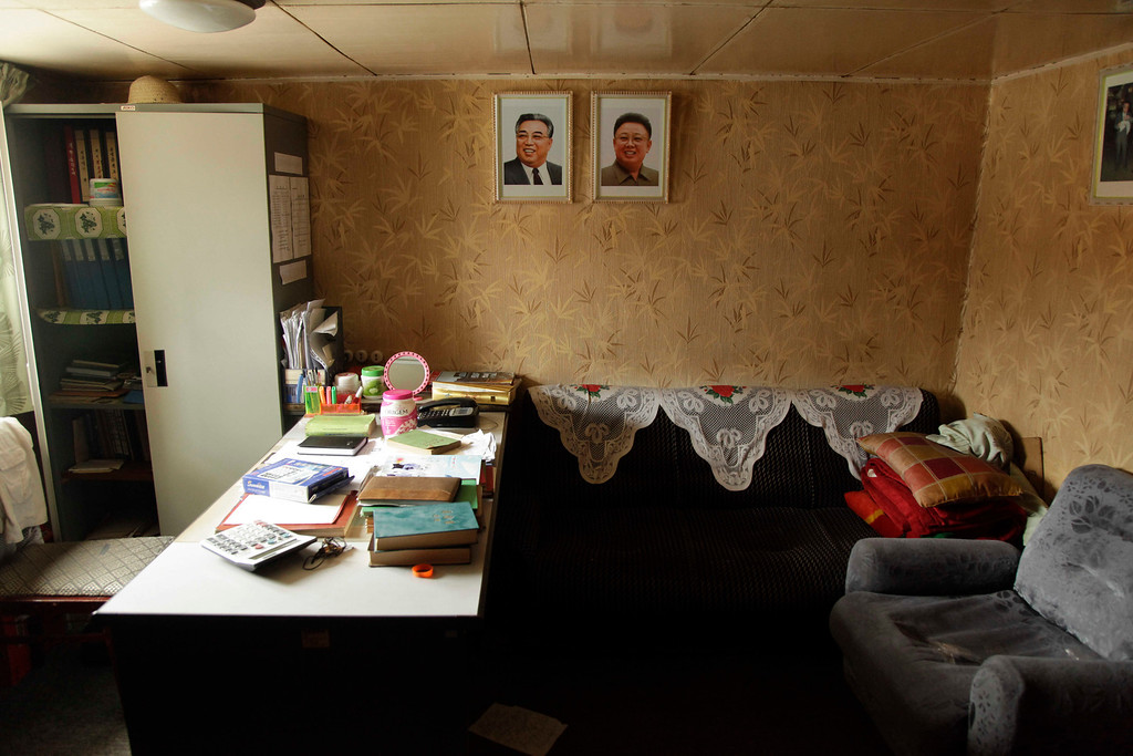Description of . Portraits of late North Korean leaders Kim Il Sung and Kim Jong Il decorate an office aboard a North Korean-flagged ship at the Manzanillo International container terminal on the coast of Colon City, Panama, Tuesday, July 16, 2013.(AP Photo/Arnulfo Franco)