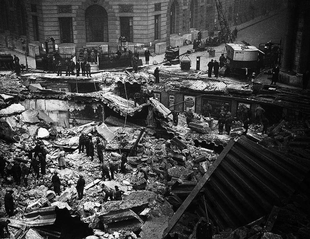 Description of . A bomb crashed through the street surface outside the Mansion House and the Bank of England in London on Jan 11, 1941 causing the Bank subway to cave in. The underground station booking-hall was wrecked, a number of people were killed and others trapped. Later Royal Engineers threw a temporary bridge across the crater. (AP Photo)