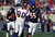 14 Nov 1999: Cris Carter #80 of the Minnesota Vikings carries the ball as he is chased by Sean Harris #55 of the Chicago Bears at the Soldier Field in Chicago, Illinois. The Vikings defeated the Bears 27-24 in overtime. Mandatory Credit: Jonathan Daniel  /Allsport