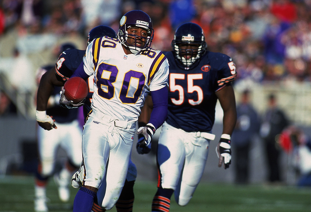 Description of . 14 Nov 1999: Cris Carter #80 of the Minnesota Vikings carries the ball as he is chased by Sean Harris #55 of the Chicago Bears at the Soldier Field in Chicago, Illinois. The Vikings defeated the Bears 27-24 in overtime. Mandatory Credit: Jonathan Daniel  /Allsport