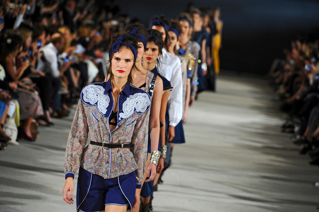 Description of . Models present creations as part of French fashion designer Alexis Mabille's ready-to-wear Spring/Summer 2014 fashion collection presented in Paris, Wednesday, Sept. 25, 2013. (AP Photo/Zacharie Scheurer)