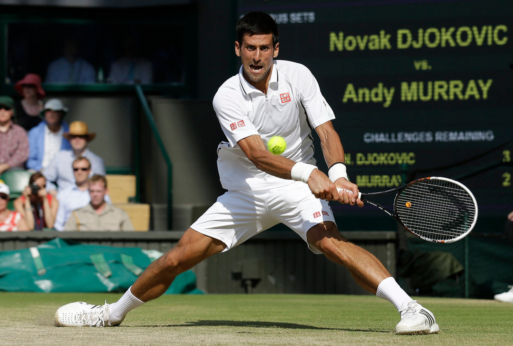 Description of . Serbia's Novak Djokovic returns against Britain's Andy Murray during the men's singles final on day thirteen of the 2013 Wimbledon Championships tennis tournament at the All England Club in Wimbledon, southwest London, on July 7, 2013.  ANJA NIEDRINGHAUS/AFP/Getty Images
