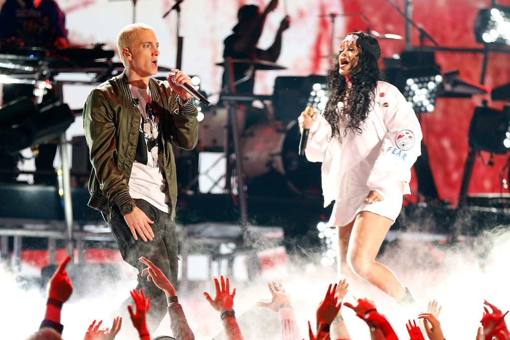 Description of . Recording artists Eminem (L) and Rihanna perform onstage at the 2014 MTV Movie Awards at Nokia Theatre L.A. Live on April 13, 2014 in Los Angeles, California.  (Photo by Christopher Polk/Getty Images for MTV)