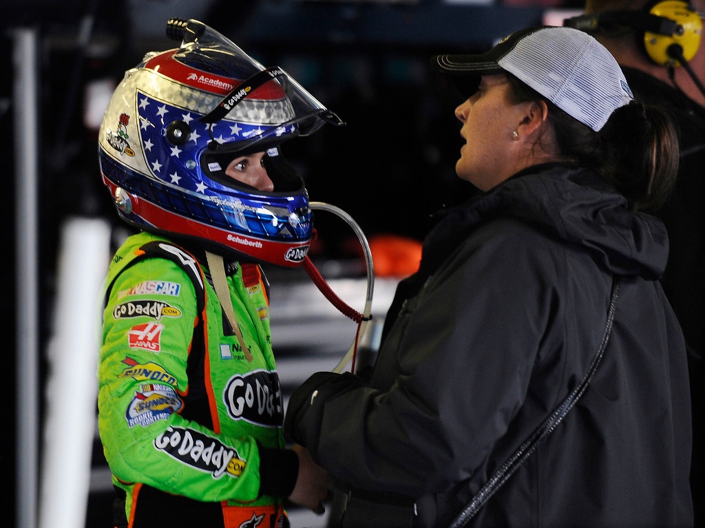 Description of . Danica Patrick talks with a team member in the Nationwide garage after crashing early in the NASCAR Nationwide Series auto race at Talladega Superspeedway in Talladega, Ala., Saturday, May 4, 2013. (AP Photo/Rainier Ehrhardt)