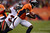 Denver Broncos wide receiver Trindon Holliday #11 returns a punt return passing Tampa Bay Buccaneers cornerback LeQuan Lewis #30 during the third quarter.  The Denver Broncos vs The Tampa Bay Buccaneers at Sports Authority Field Sunday December 2, 2012. Joe Amon, The Denver Post