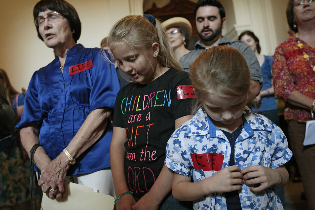 Description of . Pro-life supporters pray in the Texas State capitol on July 1, 2013 in Austin, Texas. This is first day of a second legislative special session called by Texas Gov. Rick Perry to pass a restrictive abortion law through the Texas legislature. The first attempt was defeated after opponents of the law were able to stall the vote until after the first special session had ended.  (Photo by Erich Schlegel/Getty Images)
