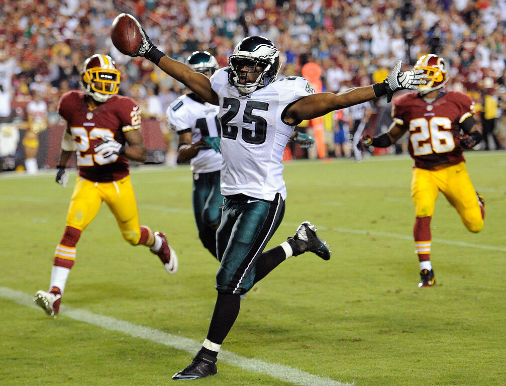Description of . Philadelphia Eagles running back LeSean McCoy celebrates has he crosses the goal line for a touchdown during the second half of an NFL football game against the Washington Redskins in Landover, Md., Monday, Sept. 9, 2013. (AP Photo/Nick Wass)