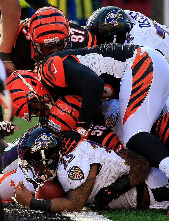Description of . Baltimore Ravens running back Anthony Allen (35) scores on a 2-yard run in the first half of an NFL football game against the Cincinnati Bengals, Sunday, Dec. 30, 2012, in Cincinnati. (AP Photo/Tom Uhlman)